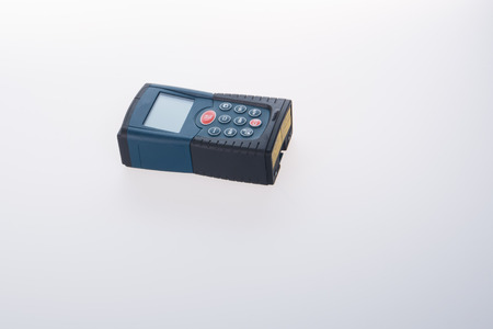 Architectural tool or laser rangefinder on a background