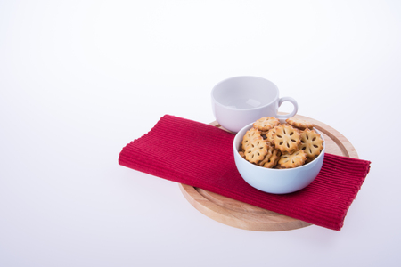 warm cloth: cookies or Tea and cookies on background