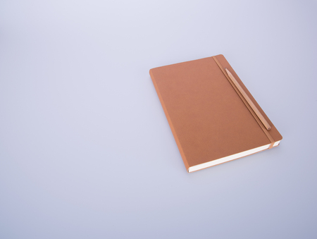novelist: notebook or leather diary and pencil on the blackground
