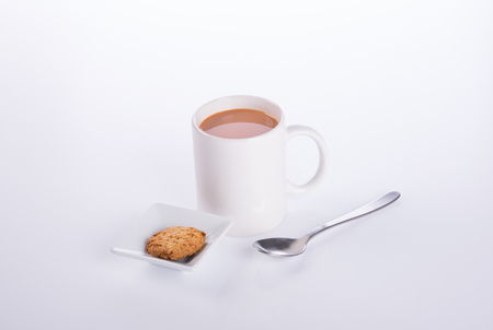 crema: coffee or coffee with cookies on background