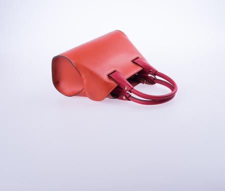 bag or brown leather woman handbag on background Stock Photo