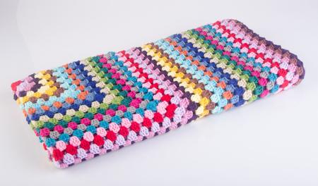 blanket or crochet blanket on a background Stock Photo