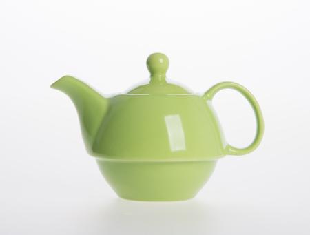 Tea pot or ceramic teapot on background Stock Photo