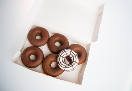 donut or box of doughnuts on a background
