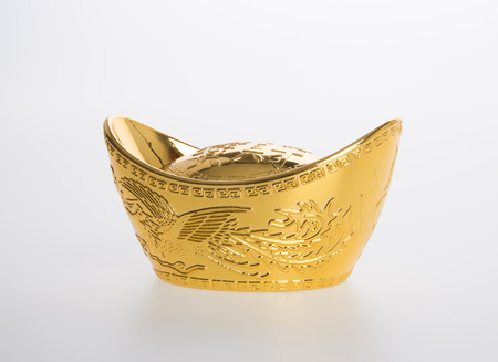 Oro o cinese oro lingotti simboli principali di ricchezza e prosperità su uno sfondo Archivio Fotografico