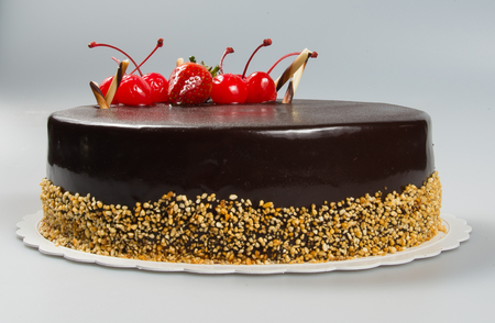cake or cake with strawberries and chocolate on a background