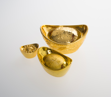 Gold or Chinese gold ingot mean symbols of wealth and prosperity on a background Stock Photo