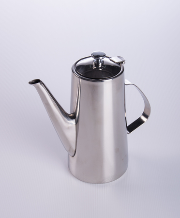 kitchen appliances: tea pots or stainless steel tea pots on the background