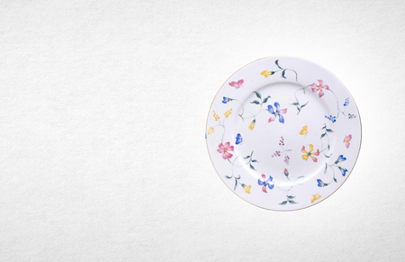 old english: plate or flowers on plate painted by hand on background Stock Photo