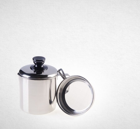 residue: Cup or Stainless steel oil cup on a background