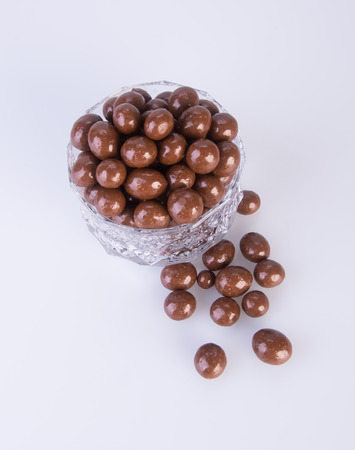 chocolate balls. chocolate balls in bowl on a background. Banco de Imagens