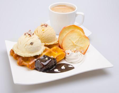 cornet: ice cream scoop. chocolate ice cream. Stock Photo