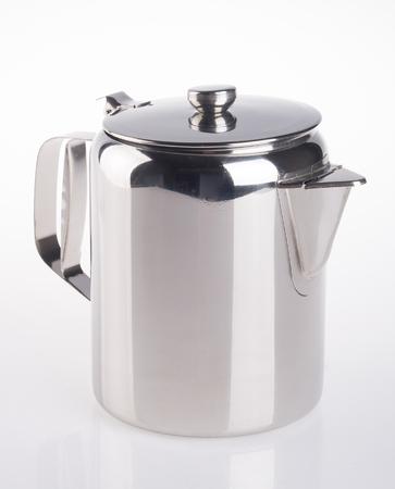 茶壷。背景にステンレス製のティーポット 写真素材