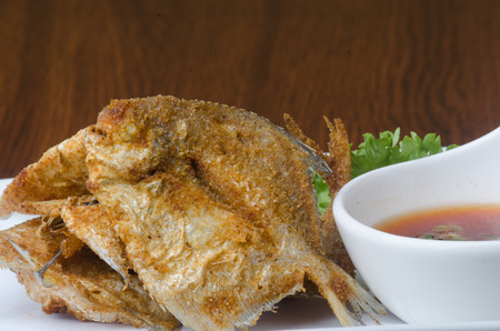 brown trout: japanese cuisine. fried fish on background
