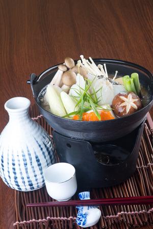 japanese cuisine. hot pot on background