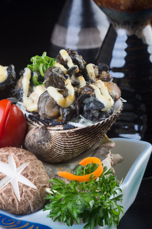 japanese cuisine. grilled shell fish on background