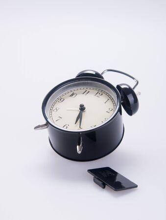 Alarm clock on white Stock fotó