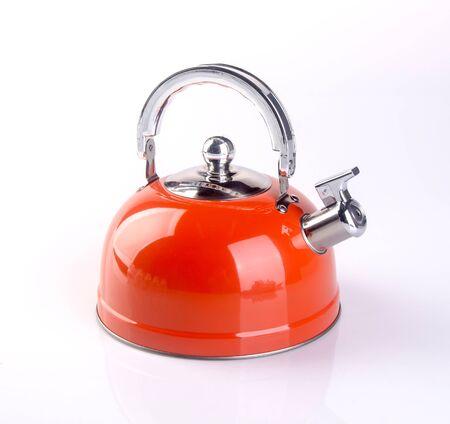 Stove top whistling kettle on white Foto de archivo