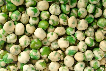nuts or green pea with crispy coated on a background new