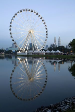 tourist spots: The Kuala Lumpur Eye on Malaysia with the Twin Towers in the Background Editorial