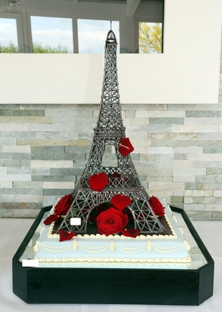 Wedding Cake As Eiffel Tower With Red Roses Stock Photo, Picture And ...