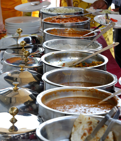 Indian food, served in stainless pots