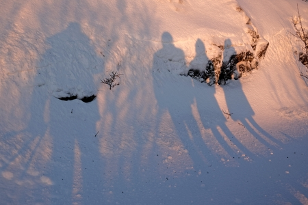 Shadows on the snow; Drekkingarhylur (the Drowning Pool) at Pingvellir National Park , South West Iceland. Stock Photo