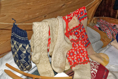 rustical: Homemade knitted socks in a a rustical bedroom in Setomaa.
