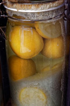 Marinated lemons on a shop window in Setubal, Portugal. Banco de Imagens - 86558521