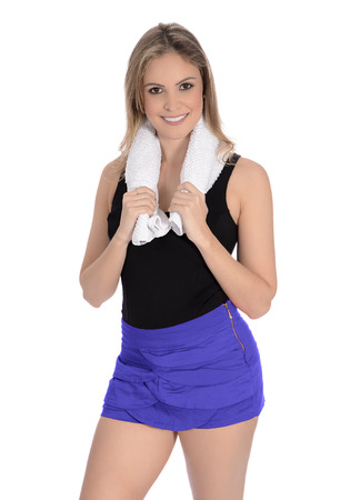 gym clothes: Woman wearing gym clothes, holding a towel