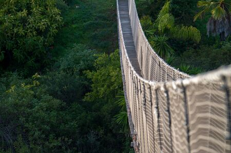 A hanging bridge is a primitive type of bridgein which the deck of the bridge lies on two parallel load-bearing cables that are anchored at eather end. Stock fotó