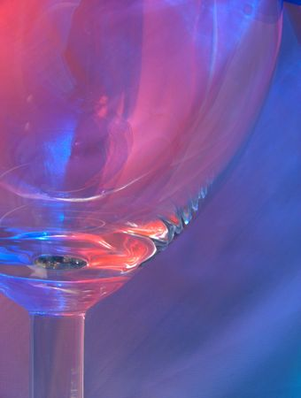 glasswear: An empty wine glass with red & blue reflections
