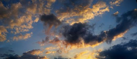 atmosphere: Clouds in the atmosphere.  The sun is setting.  Will it storm? Stock Photo
