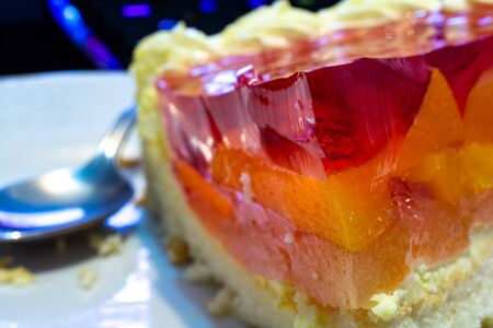Cheesecake with peach and strawberry jelly macro Reklamní fotografie