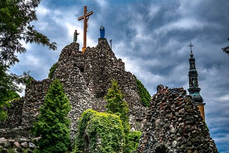 Golgotha mountain with a cross on top on a cloudy day Stock Photo