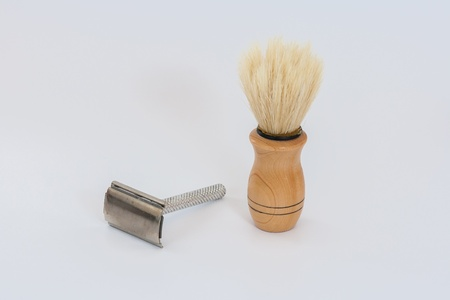 metal blade and wood brush for shaving Stock Photo - 13447477