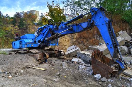 power shovel: Broken excavator, power shovel on a dump