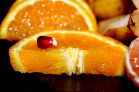 Orange segments on a black background Stock Photo