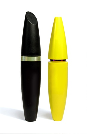 Black and yellow box with mascara stands upright on a white background close-up.