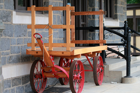 Wood trolley outside a house