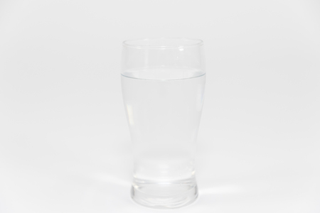 Water glass isolated on white Фото со стока