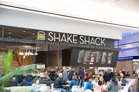 Philadelphia, Pennsylvania, May 19 2018: Shake Shack store front in Philadelphia. Shake Shack is a trendy food chain known for quality. People can be seen.