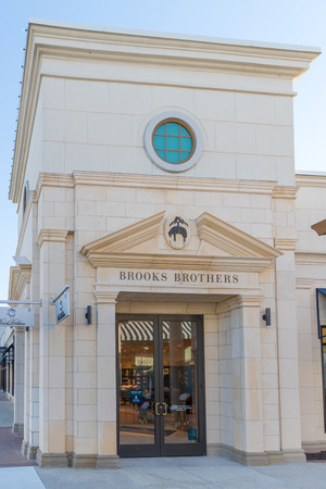 Philadelphia, Pennsylvania, June 19, 2018: View of the Brooks Brothers clothing store golden. Brooks Brothers is the oldest men's clothier in the United States.