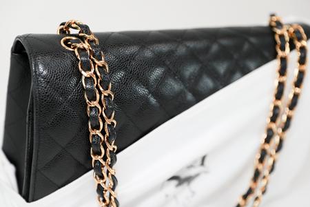 Philadelphia, Pennsylvania, USA, August 10, 2018: Photo of black Chanel handbag with Chanel dust bag brand Editorial on white background. Editorial