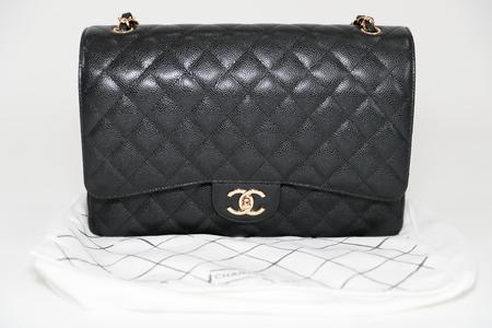 713737d5cdbc ... dust bag brand Editorial on white background. Philadelphia,  Pennsylvania, USA, August 10, 2018: Photo of black Chanel handbag