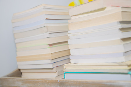 Stack of colorful books on background - Image