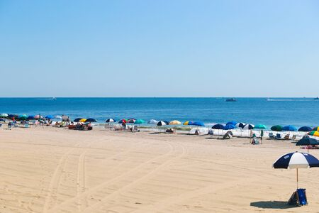 Allenhurst New Jersey August 10, 2019: Bradley beach people enjoy the sunlight on the beach. 報道画像