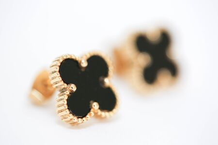 Small black clover earrings on white background. - Image 写真素材