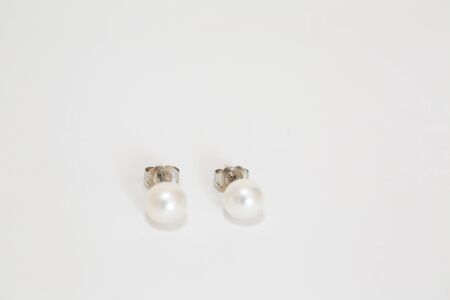 White pearl pieced earrings pair fine jewelry isolated on white - Image