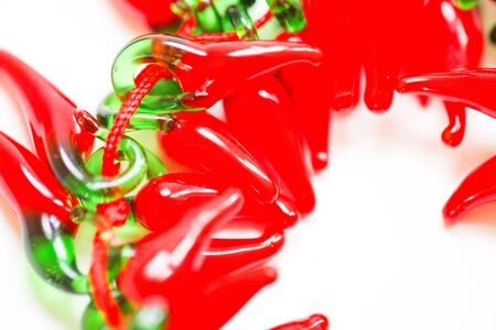 Red glass decorative peppers on white background with copy space. - Image 写真素材 - 132383763